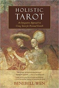 "Cover of ""Holistic Tarot: An Integrative Approach to Using Tarot for Personal Growth"" by Benebell Wen; detail from ""The Tarocchi Players"" by Gionvanni da Vapiro."